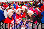 Kelly Robbins, Lorraine Lynch, Layla Lynch, Orla O'Byrne and Clodagh Lynch, pictured at the Santa 5k run which took place at Tralee Wetlands Centre on Sunday.