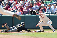 NWA Democrat-Gazette/CHARLIE KAIJO Arkansas Razorbacks infielder Trevor Ezell (4) makes a catch as University of Missouri infielder Chris Cornelius (7) slides to first during a baseball game, Sunday, March 17, 2019 at Baum-Walker Stadium in Fayetteville.