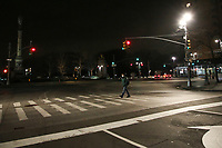 NEW YORK, NY - MARCH 19: A man walks across Columbus Circle at night as the city struggles to curb the number of coronavirus cases on March 19, 2020 in New York City. Gov Cuomo has ordered nonessential businesses in the state to close by 8 p.m. Sunday as more than 11,000 confirmed cases and 56 deaths. (Photo by Pablo Monsalve / VIEWpress via Getty Images)