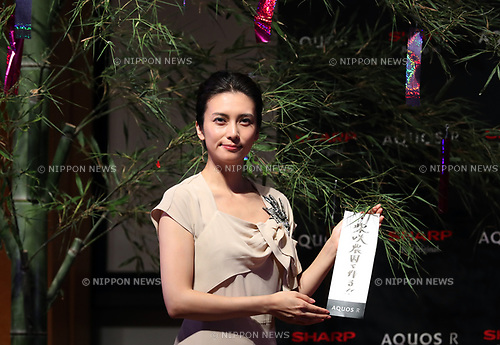 """July 4, 2017, Tokyo, Japan - Japanese actress Ko Shibasaki hangs up a paper strip with written her wish """"to make my family farm"""" on a bamboo tree for Tanabata festival as she attends a promotional event of Japanese electronics giant Sharp's new smart phone """"Aquos R"""" in Tokyo on Tuesday, July 4, 2017. Aquos R will go on sale on July 7, the day of Tanabata festival.   (Photo by Yoshio Tsunoda/AFLO) LwX -ytd-"""