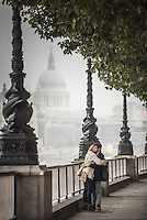 Couple on South Bank with St Paul's Cathedral behind, London, England