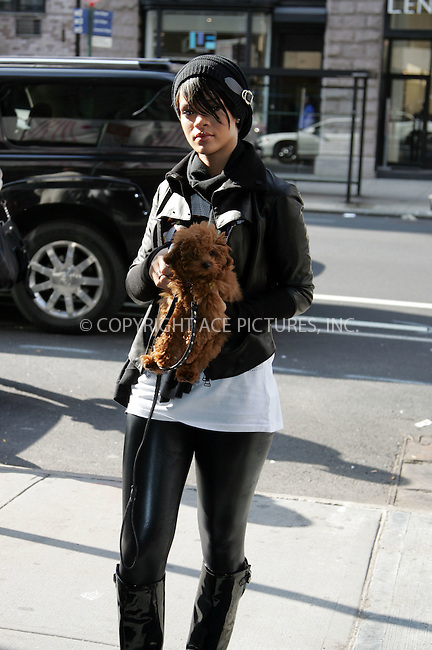 WWW.ACEPIXS.COM . . . . . ....October 10 2007, New York City....Recording artist Rihanna left her downtown hotel with her dog and picked it up to put it in the car. She then went to Armani Exchange on Fifth Avenue, coming out an hour later with an Armani bag.....Please byline: DAVID MURPHY - ACEPIXS.COM.. . . . . . ..Ace Pictures, Inc:  ..(646) 769 0430..e-mail: info@acepixs.com..web: http://www.acepixs.com
