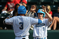 Brett Stephens (9) of the UCLA Bruins greets teammate Ryan Kreidler (3) after his home run against the Arizona Wildcats at Jackie Robinson Stadium on March 19, 2017 in Los Angeles, California. UCLA defeated Arizona, 8-7. (Larry Goren/Four Seam Images)