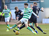 17th March 2019, Dens Park, Dundee, Scotland; Ladbrokes Premiership football, Dundee versus Celtic; Mikey Johnston of Celtic and Martin Woods of Dundee  challenge for the ball