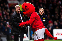 Saturday 11 January 2014 Pictured: David Moyes, Manager of Manchester United is embraced by the  Manchester United club mascot <br /> Re: Barclays Premier League Manchester Utd v Swansea City FC  at Old Trafford, Manchester