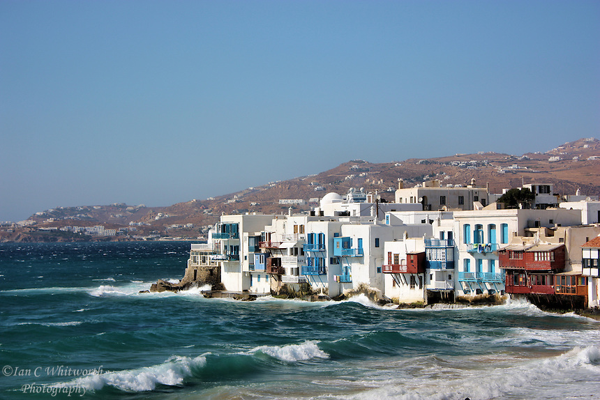 Looking across the waves at Little Venice at Mykonos in Greece