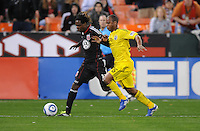 DC United forward Joseph Ngwenya (11) goes against Columbus Crew defender Julius James (26)     DC United defeated The Columbus Crew 3-1  at the home season opener, at RFK Stadium, Saturday March 19, 2011.