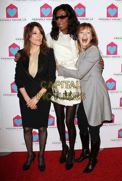MARIANNE WILLIAMSON, NATALIE COLE &amp; FRANCES FISHER <br /> Friendly House&iacute;s 21st Annual Awards held at Sky Bar at The Beverly Hilton Hotel, Beverly Hills, CA, USA, <br /> 9th October 2010.<br /> full length white black coat tights sunglasses grey gray jacket skirt knee high boots shoes arm around hug hugging <br /> CAP/ADM/KB<br /> &copy;Kevan Brooks/AdMedia/Capital Pictures