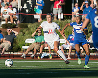 In a National Women's Soccer League Elite (NWSL) match, the Boston Breakers defeated the FC Kansas City, 1-0, at Dilboy Stadium on August 10, 2013.  FC Kansas City midfielder Kristie Mewis (19) and Boston Breakers defender Jazmyne Avant (5) race for a loose ball.