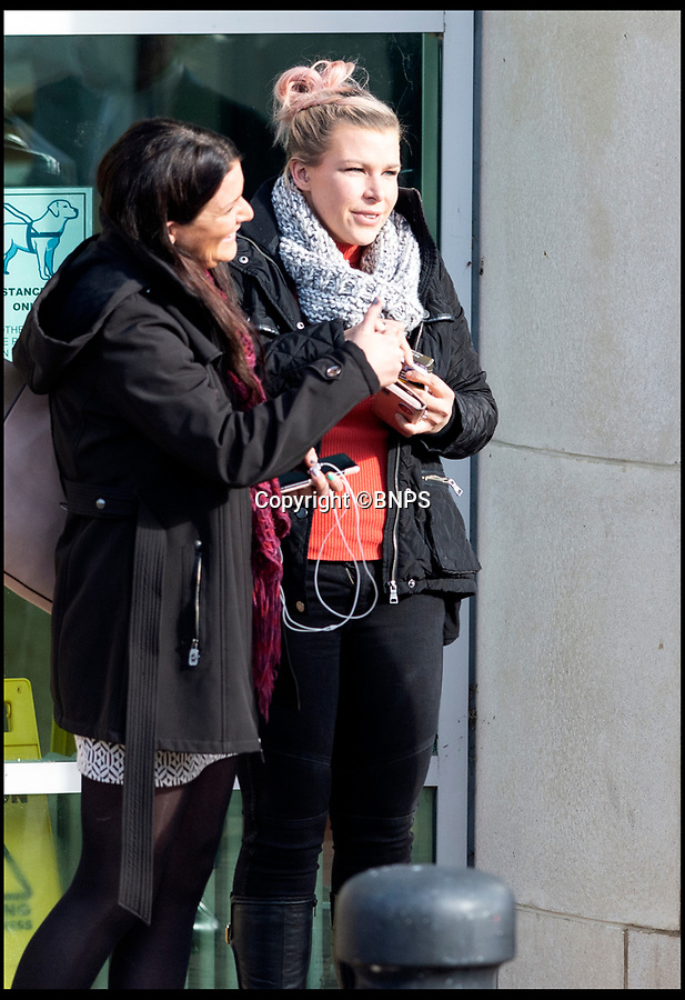 BNPS.co.uk (01202 558833)<br /> Pic:  RogerArbon/BNPS<br /> <br /> Clara Martin (on the right) outside Bournemouth Crown Court.<br /> <br /> This is the moment a businessman hugs the girlfriend he almost killed by pushing her over a 20ft wall after her forgiveness helped spare him from prison.<br /> <br /> Andrew Pilliner grabbed Clara Martin around the throat, picked up her legs and launched her over the parapet during a drunken argument on a night out.<br /> <br /> Miss Martin landed head first on concrete and suffered a broken neck and a head injury but luckily survived.<br /> <br /> Despite the seriousness of the attack, Miss Martin told police officers from her hospital bed that she still loved her partner of 10 years and did not want him to face charges.