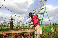 BURKINA FASO, Dano, foundation Dreyer, rice mill with solar cooker, steam is produced by parabolic mirror to process paddy / BURKINA FASO, Dano, Stiftung Dreyer, Reismuehle mit Solaranlage mit Parabolspiegeln zur Dampferzeugung fuer Reisverarbeitung
