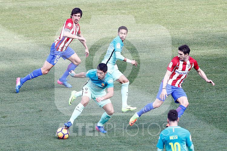 Atletico de Madrid's Stefan Savic (l) and Sime Vrsaljko (r) and FC Barcelona's Neymar Santos Jr (c-r) and Luis Suarez during La Liga match. February 26,2017. (ALTERPHOTOS/Acero)