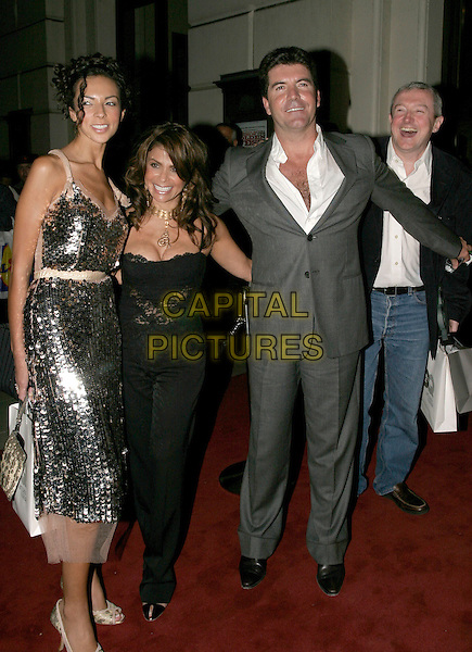 TERRI SEYMORE, PAULA ABDUL, SIMON COWELL & LOUIS WALSH.The 8th Anual GQ Men of The Year Awards,.The Royal Opera House,.London, 6th September 2005.full length navy jacket grey gray suit bags black top trousers arm.www.capitalpictures.com.sales@capitalpictures.com.© Capital Pictures.