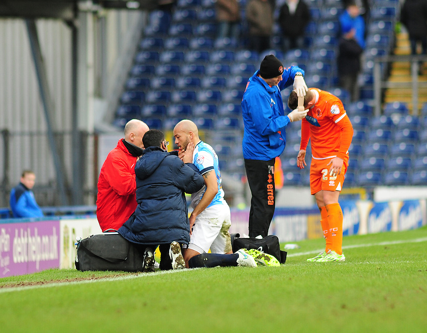 Blackburn Rovers' Alex John-Baptiste and Blackpool's David Ferguson receive treatment for head injuries<br /> <br /> Photographer Andrew Vaughan/CameraSport<br /> <br /> Football - The Football League Sky Bet Championship - Blackburn Rovers v Blackpool - Saturday 21st February 2015 - Ewood Park - Blackburn<br /> <br /> &copy; CameraSport - 43 Linden Ave. Countesthorpe. Leicester. England. LE8 5PG - Tel: +44 (0) 116 277 4147 - admin@camerasport.com - www.camerasport.com