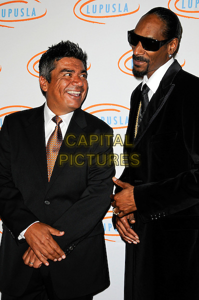 GEORGE LOPEZ & SNOOP DOGG (Cordozar Calvin Broadus).Lupus LA Orange Ball 2010 held at the Beverly Wilshire Hotel, Beverly Hills, California, USA..6th May 2010. .half length tie white shirt black sunglasses goatee beard facial hair smiling bronze gold shades .CAP/ROT.©Lee Roth/Capital Pictures