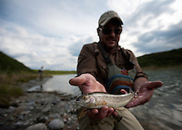 150620-JRE-7981E-0038 Cal Trout, a teacher and quail hunting guide from Mississippi, shows off his first Arctic Grayling, caught on a tundra pond in interior Alaska.