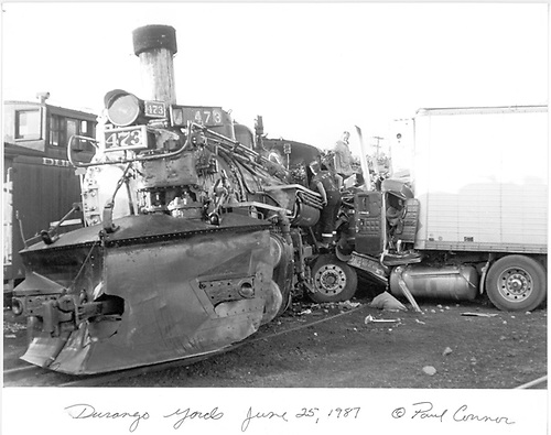 D&amp;RGW #473 broadsided by potato truck in Durango yard.<br /> D&amp;S  Durango, CO  Taken by Connor, Paul - 6/25/1987