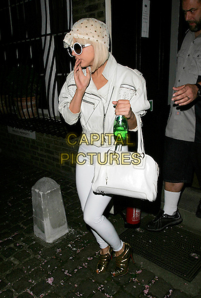 LADY GAGA.Seen leaving Blake's Hotel, London, England, UK, April 21st 2009..full length white sunglasses round frames glasses leggings bag leather jacket zips gold polka dot headscarf head scarf shiny open toe ankle boots shoes booties pvc green perrier water bottle drink .CAP/AH.©Adam Houghton/Capital Pictures