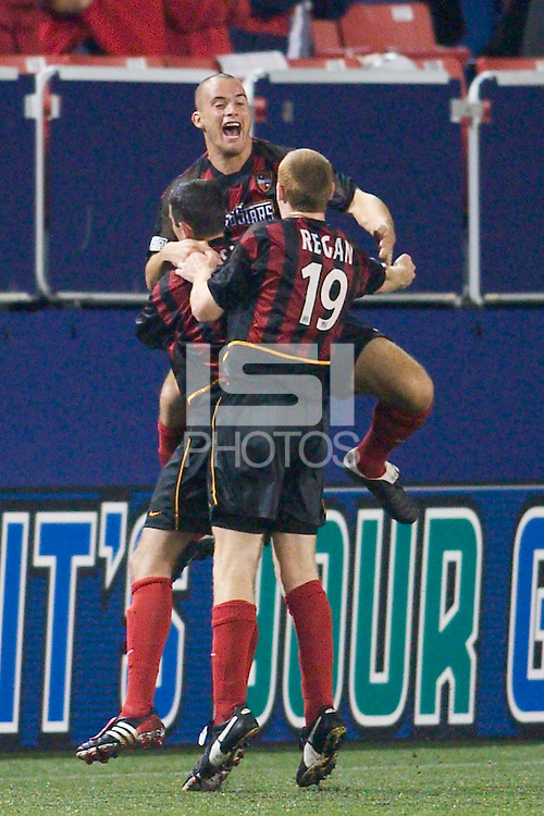 Steve Jolley of the MetroStars celebrates scoring the game winning goal with Mark Lisi and Tim Regan. The Dallas Burn were defeated by the NY/NJ MetroStars 2-1 on 5/24/03 at Giant's Stadium, East Rutherford, NJ.