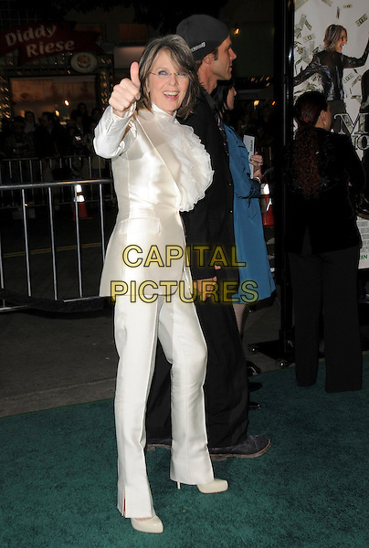 """DIANE KEATON & GUEST.Overature Pictures' L.A. Premiere of """"Mad Money"""" held at The Mann Village Theatre in Westwood, California, USA..January 9th, 2008.full length white suit trousers jacket satin silk ruffles ruffles blouse top hand arm thumb up holding beanie suit balck glasses.CAP/DVS.©Debbie VanStory/Capital Pictures"""
