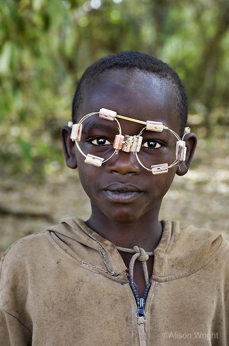 Boy in homemade glasses, 2006