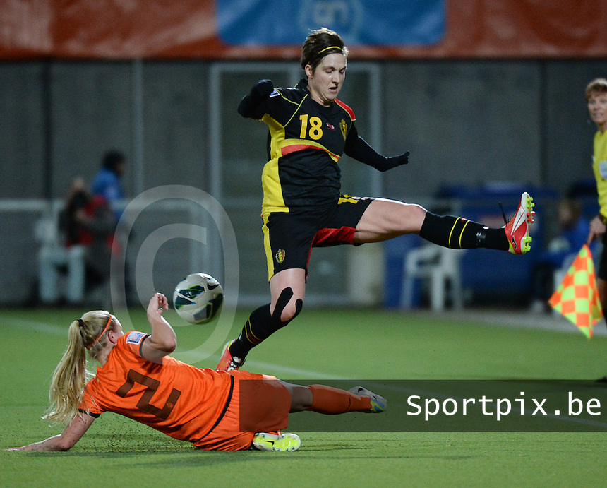 20140212 - ZWOLLE , THE NETHERLANDS : Belgian Maud Coutereels (r) pictured with tackling Dutch Kika Van Es (l) during the female soccer match between The Netherlands and Belgium , on the fifth matchday in group 5 of the UEFA qualifying round to the FIFA Women World Cup in Canada 2015 at Het Ijseldelta Stadion , Zwolle . Wednesday 12th February 2014 . PHOTO DAVID CATRY