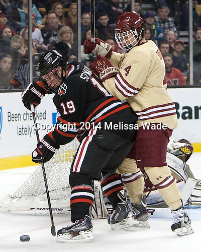 Mike Szmatula (NU - 19), Teddy Doherty (BC - 4) - The Boston College Eagles defeated the Northeastern University Huskies 4-1 (EN) on Monday, February 10, 2014, in the 2014 Beanpot Championship game at TD Garden in Boston, Massachusetts.