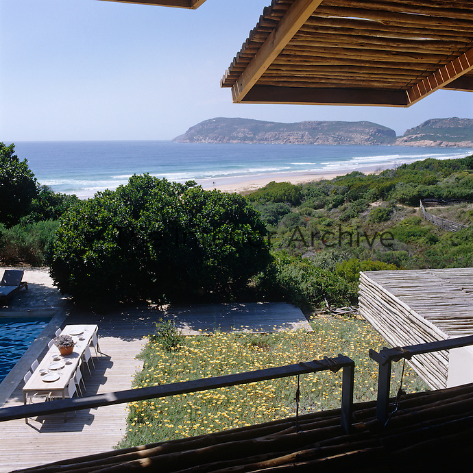 View under the raised latte shutters towards Plettenberg Bay and the Robberg Peninsula