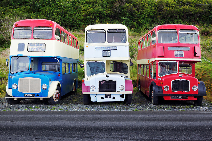 Three old British double decker buses parked along roadside, Alert Bay, Vancouver Island, Canada