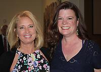 NWA Democrat-Gazette/CARIN SCHOPPMEYER Lisa Vail (left) and Candace Dixon-Horne enjoy the BOST dinner.