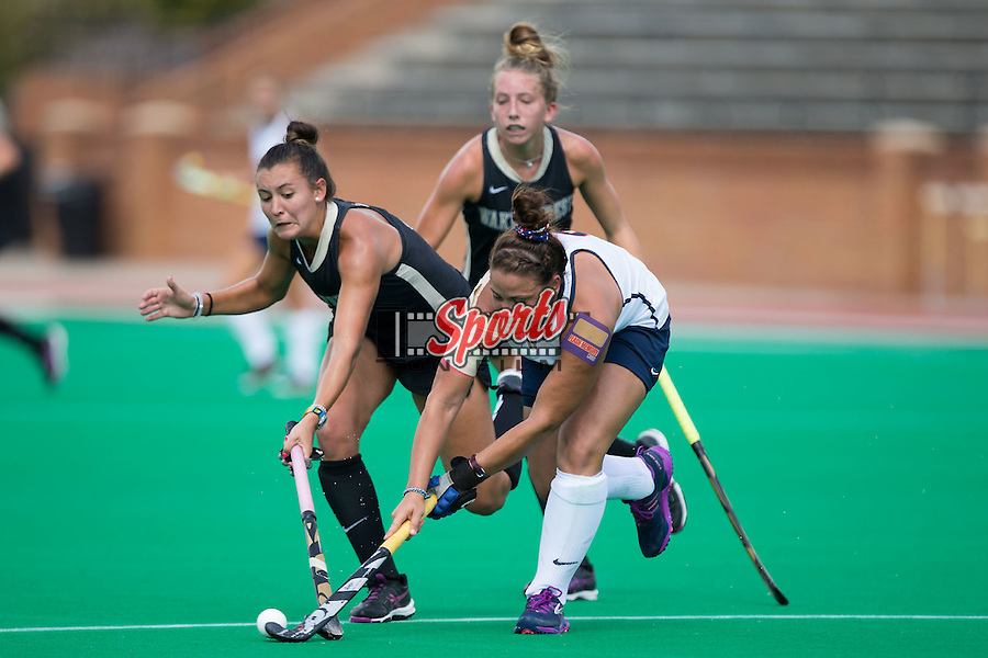 Karlee Spirit (13) of the Wake Forest Demon Deacons tries to get the ball away from Hannah Jones (8) of the Liberty Flames during first half action at Kentner Stadium on September 20, 2015 in Winston-Salem, North Carolina.  The Demon Deacons defeated the Flames 2-1.  (Brian Westerholt/Sports On Film)