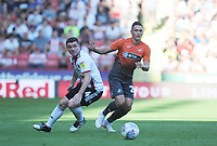 Sheffield United's John Fleck vies for possession with Swansea City's Connor Roberts during the Sky Bet Championship match between Sheffield United and Swansea City at Bramall Lane, Sheffield, England, UK. Saturday 04 August 2018