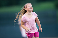 A young Kannapolis Intimidators fan is all smiles as she wins the mascot race between innings of the game against the Delmarva Shorebirds at Kannapolis Intimidators Stadium on July 3, 2017 in Kannapolis, North Carolina.  The Shorebirds defeated the Intimidators 5-2.  (Brian Westerholt/Four Seam Images)