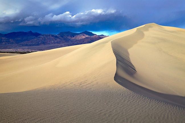 Breaking thunderstorm over Mesquite Dunes, Death Valley National Park, California