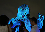 July 18, 2014, Tokyo, Japan - Visitors stand in front of a 6.6 meter tall replica model of Godzilla at Tokyo Midtown in downtown Tokyo on Friday, July 18, 2014. The Godzilla display runs from July 18 to August 31. (Photo by AFLO)