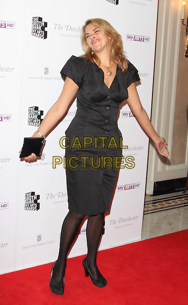 Tracey Emin.South Bank Sky Arts Awards at the Dorchester Hotel, Park Lane, London, England..May 1st 2012.full length black dress shirt tights union jack clutch bag smiling hands arms funny.CAP/ROS.©Steve Ross/Capital Pictures