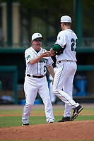 Dartmouth Big Green head coach Bob Whalen (2) takes the ball from relief pitcher Marc Bachman (21) while making a pitching change during a game against the South Florida Bulls on March 27, 2016 at USF Baseball Stadium in Tampa, Florida.  South Florida defeated Dartmouth 4-0.  (Mike Janes/Four Seam Images)