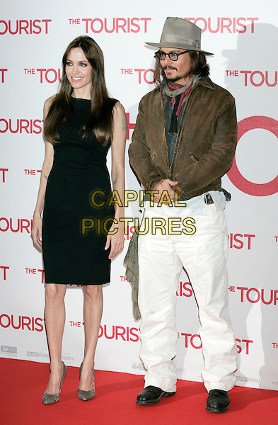 "ANGELINA JOLIE & JOHNNY DEPP.""The Tourist"" photocall, Berlin, Germany..December 14th, 2010 .full length scarves scarf glasses goatee facial hair hat grey gray brown leather jacket white trousers jeans denim black sleeveless dress shoes.CAP/PE.©Peter Eden/Capital Pictures."