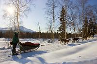 Matt Hayashida leaves Takotna Chkpt after 24hr layover Takotna 2006 Iditarod Alaska Winter