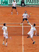 Britain's Andy Murray returns the Ball  during their Davis Cup quarter-final doubles tennis match against Italy's in Naples April 5, 2014.
