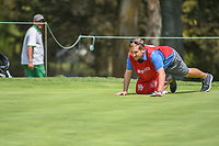 Matt Fitzpatrick's (ENG) caddie, Jamie Lane gets low to line up a putt on 2 during round 1 of the World Golf Championships, Mexico, Club De Golf Chapultepec, Mexico City, Mexico. 3/1/2018.<br /> Picture: Golffile | Ken Murray<br /> <br /> <br /> All photo usage must carry mandatory copyright credit (&copy; Golffile | Ken Murray)