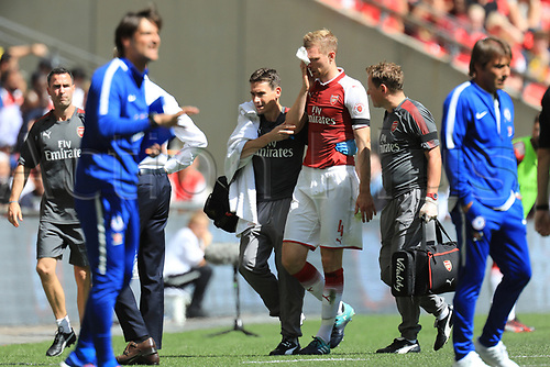August 6th 2017, Wembley Stadium, London, England; FA Community Shield Final; Arsenal versus Chelsea; Per Mertesacker of Arsenal is taken off with a bleeding head injury