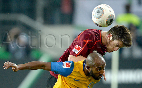 08.11.2013. Hanover, Germany.  Hanover's Sebastien Pocognoli (top) and Braunschweig's Domi Kumbela challenge for the header during the Bundesliga soccer match between Hannover 96 and Eintracht Braunschweig in Hanover, Germany, 8 November 2013.