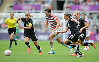 Newcastle, England - Friday, August 3, 2012: The USA women defeated New Zealand 2-0 in the quarterfinal round of the 2012 Olympics at St. James Park. Abby Wambach dribbles the ball.