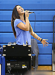 Marymount University Assistant Volleyball Coach Johannah Zabal sings the National Anthem on Senior Day at Marymount University, in Arlington, Vir., on Saturday, Nov. 1, 2014.<br /> Photo by Cathleen Allison
