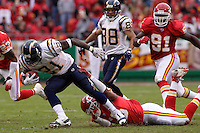 San Diego Chargers running back LaDainian Tomlinson picks up some yards as he is tackled by Chiefs linebacker Derrick Johnson at Arrowhead Stadium  in Kansas City, MO on October 22, 2006. The Chiefs won 30-27.