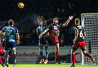 Marcus Bean of Wycombe Wanderers beats Jordan Turnbull of Coventry City to the ball during the The Checkatrade Trophy Southern Group D match between Wycombe Wanderers and Coventry City at Adams Park, High Wycombe, England on 9 November 2016. Photo by Andy Rowland.