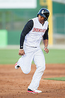 Tyler Williams (6) of the Kannapolis Intimidators hustles towards third base against the Hickory Crawdads at CMC-Northeast Stadium on May 18, 2014 in Kannapolis, North Carolina.  The Intimidators defeated the Crawdads 6-5 in 10 innings.  (Brian Westerholt/Four Seam Images)
