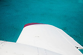 EXUMA, Bahamas. Airplane wing and the blue waters of the Atlantic around the Exuma Islands.