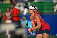 July 24, 2013  (Washington, DC)  Martina Hingis and Leander Paes (back, left) set up during a doubles match with the Boston Lobsters at Kastles Stadium in the District of Columbia. (Photo by Don Baxter/Media Images International)